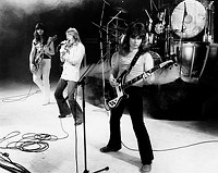 Photo of The Sweet 1977 Andy Scott, Brian Connolly, Steve Priest an